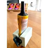 Dévidoir distributeur pour tube de colle